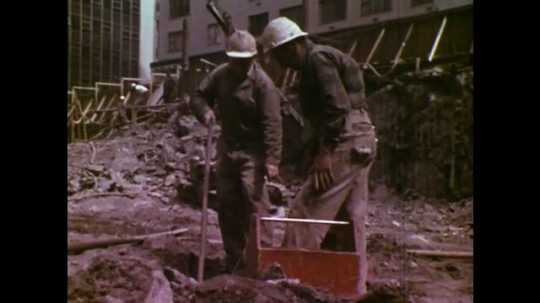 UNITED STATES: 1970S: engineers seal off top of blast holes. Dynamite and electrical cables.