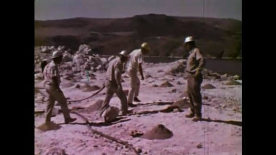 UNITED STATES: 1970S: engineers install gel at blast sites. Explosives pumped from truck into hole.