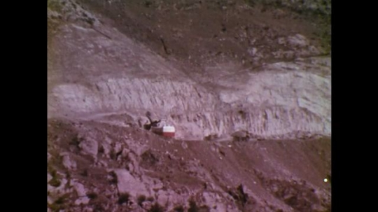 UNITED STATES: 1970S: machines work at blast site in gorge. Hydroelectric dam.