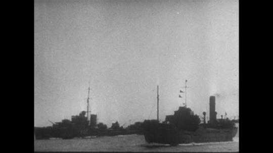 Europe 1940s: British ships in English Channel. Dive-bomber planes over English Channel. Bombs fall from plane. Bombs hit ship.
