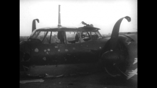 Europe 1940s: wreckage of German plane on ground. Animation of planes over England map.  German and English planes over coast of Britain. Missiles fall from plane. English pier hit by air fire.