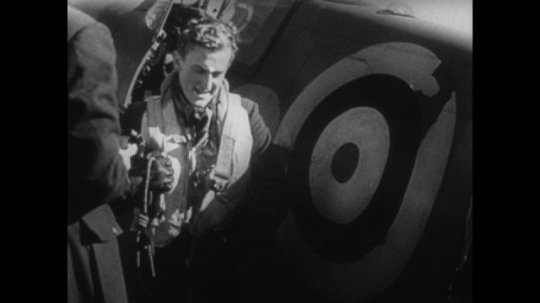 Europe 1940s: pilot stands on ground and talks. Animation of planes and calendar. Soldiers patrol coast