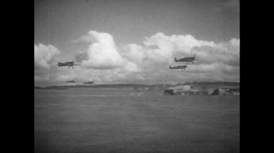 Europe 1940s: planes take off from runway.  View of planes through window. Planes fly over clouds. Planes in formation. Gunfire from planes. Bullets in air.