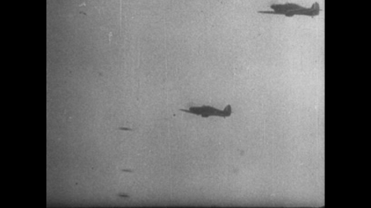 Europe 1940s: military planes in battle. Damage on side of plane as bullets hit. Plane takes bad hot and goes down. Plane crashes into ground. Planes in dog fight in sky. Bullets hit side of plane
