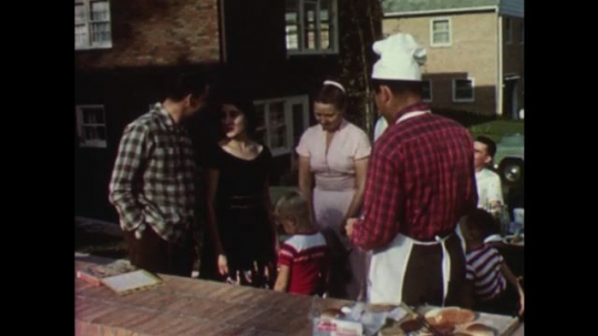UNITED STATES: 1950s: Guests talk to barbecue hosts. Guests leave party.