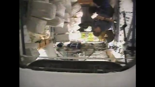 UNITED STATES: 1980s: astronauts learn how to adapt to microgravity environment on space shuttle