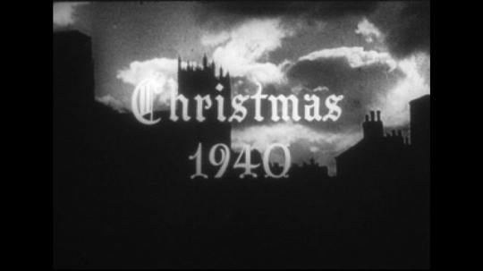 Europe 1940s: title for Christmas 1940. View of church. Boy sings solo in choir. Boy's choir performs Christmas service. Soldier met by child at home.