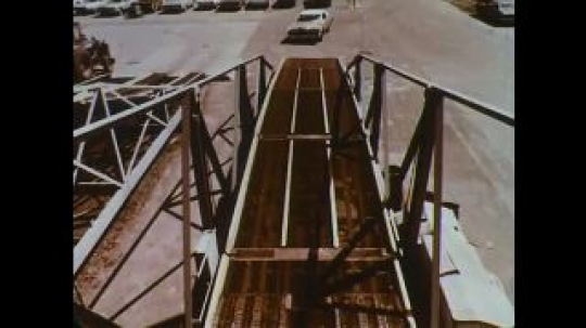 UNITED STATES: 1960s: new car drives up ramp ready for export.