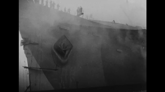 United States: 1940s: clouds of smoke around ship. Ladder swings towards ship.