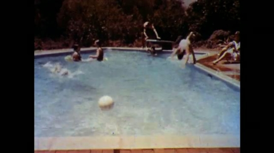 United States: 1960s: people play in swimming pool. Boy chases ball in pool. Lady in bed. Lady can't sleep.