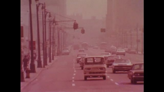 UNITED STATES: 1970s: vehicles on road. Air pollution. Scientist monitors air pollution from cars.