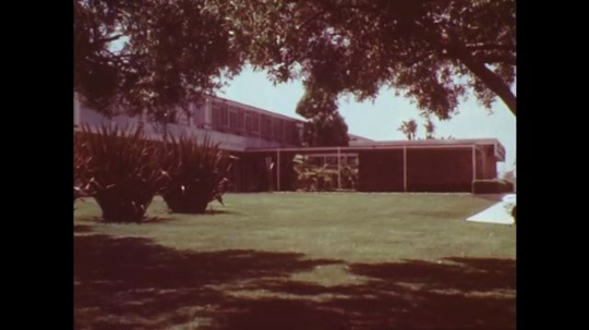 UNITED STATES: 1970s: Vehicle Emission Laboratory grounds and building. Assembly line testing of vehicles.