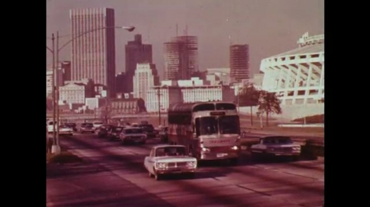 UNITED STATES: 1970s: traffic on road in city. Freeway from above.