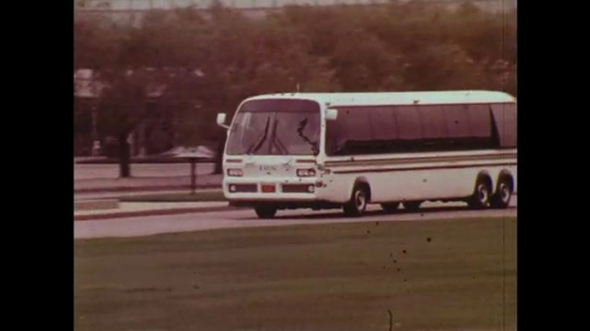 UNITED STATES: 1970s: rapid transit coach on road. Drawing of transport options
