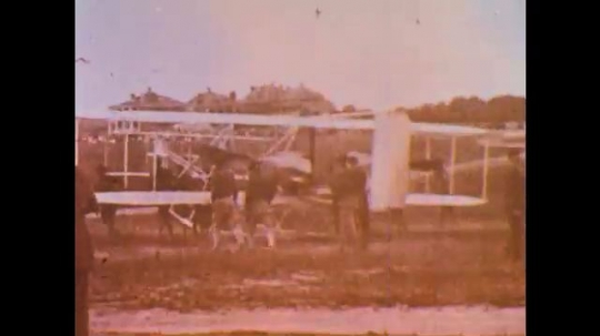 UNITED STATES: 1950s: men fly early aircraft from field. Wright Brothers. Commercial aircraft lands.