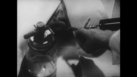 United States, 1930s: hands inject fluid into pipe. Fluid loss replaced. Blood pressure increases on scale.
