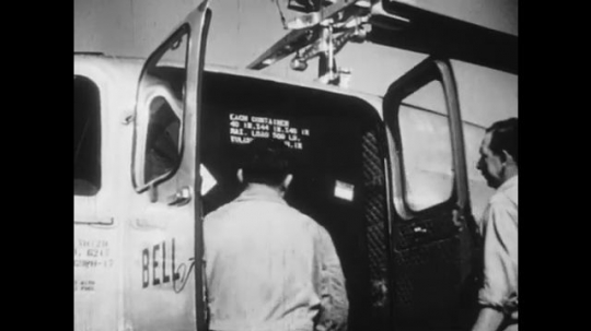UNITED STATES: 1950s: Men load cargo and mail onto Sikorsky helicopter. Bell helicopters used on land to spray crops and orchards. Cattle.
