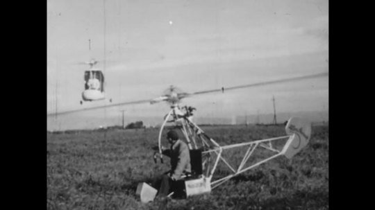 UNITED STATES: 1950s: men fly helicopters in field. Men in factory. Machines and engines. Jet engines.