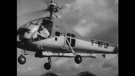 UNITED STATES: 1950s: man flies jet driven helicopter. Little Henry helicopter experimental flight
