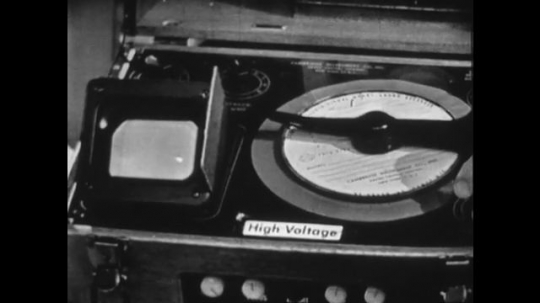 United States 1960s: finger points at representation of heart beat on machine monitor. Moving disc on machine. High voltage label on machine. Fingers point at disc.