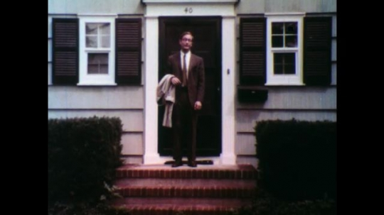 United States: 1950s: man in front of house talks to camera.