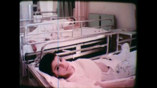 United States: 1950s: boy in hospital bed. Children in hospital ward. Disabled children in hospital beds.