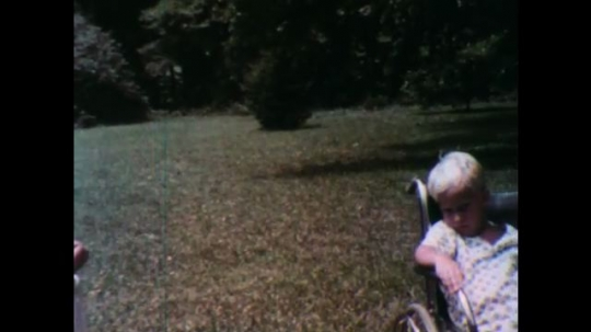 United States: 1950s: boy in wheelchair. Close up of boy
