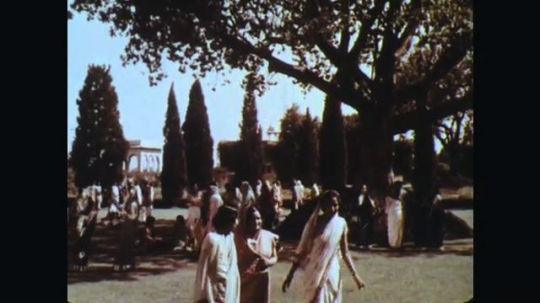 INDIA: 1960s: . People walk through grounds of building and park. Women walk through grounds.