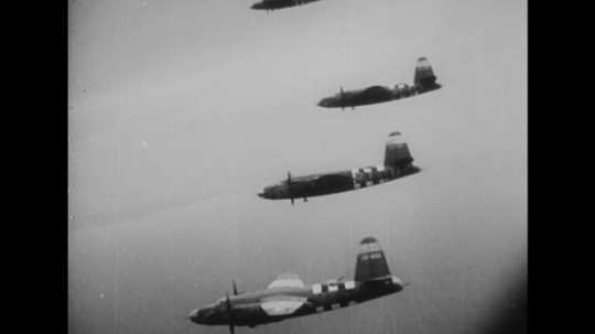 EUROPE: 1940s: bomber panes in sky. Bombs dropped from planes. Soldiers march under aircraft. Men put on packs. Planes take off.