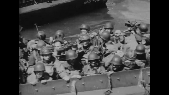 EUROPE: 1940s: soldiers on landing boats. Ships at sea. Bombs hot ships on water. Soldiers fire from ship