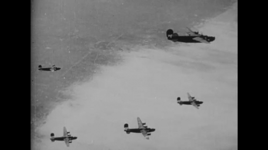 EUROPE: 1940s: military planes in air. Planes fire on ground. Bombs drop. Ship hit by bomb