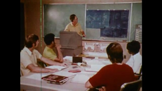 United States, 1971: Man points to board, Students in class, Man at work.