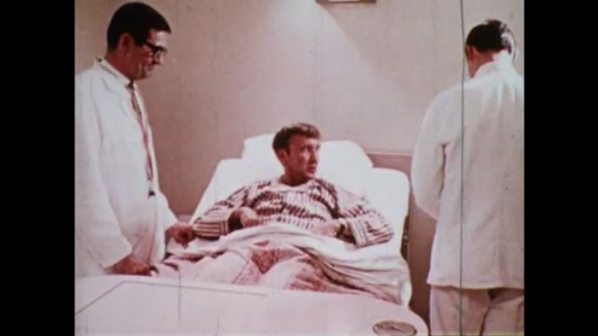 UNITED STATES 1970s: Doctors at bedside / Woman walks up to house and rings doorbell / Man cleans window / Woman makes a bed / Engineer fixes wires / Floor scrubber / Man enters gated weather station