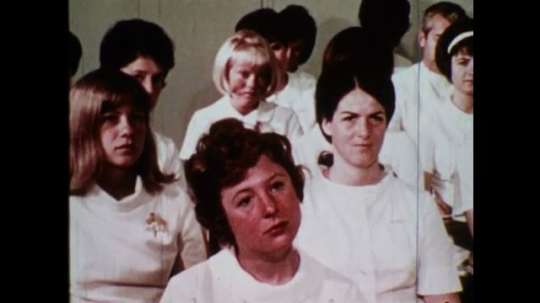 UNITED STATES 1970s: Class of mostly women being taught / Class in a military uniform being taught