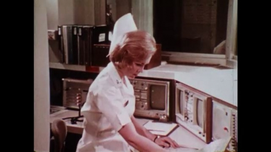 UNITED STATES 1970s: Nurse checks chart / Man checks under microscope / Woman listens to chest / Woman injects syringe into mouth / Doctors care for a person on a stretcher / Man laid down for X-ray