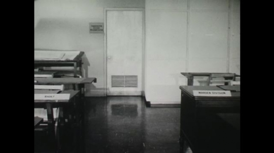 UNITED STATES: 1950s: emergency operating center desks in office.