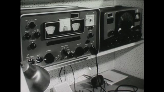 UNITED STATES: 1950s: Emergency operating center and communications equipment. Red cross in disaster situation. People in camp.