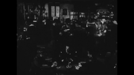 UNITED STATES: 1940s: men drink in bar. Soldier drinks at bar.