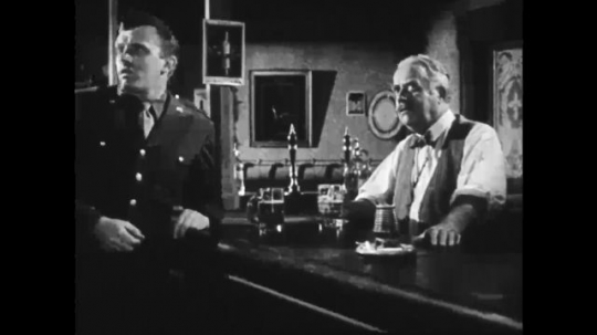UNITED STATES: 1940s: Soldier in pub. Planes in sky drop bombs. Buildings after bombing.