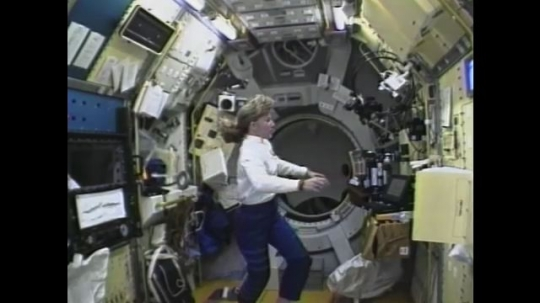 UNITED STATES: 1990s: female astronaut in space. Astronauts on space walk.