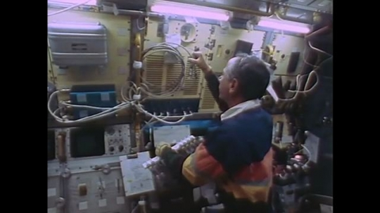 UNITED STATES: 1990s: scientist on space shuttle. Microgravity research facility.