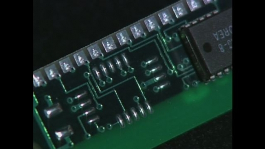 UNITED STATES: 1990s: silicon chip. Animated molecule. Crystal under microscope. Semi conductor chips.