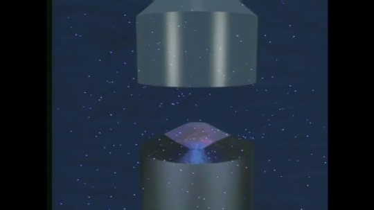 UNITED STATES: 1990s: animation of container filled with seed and solution. Material science research.