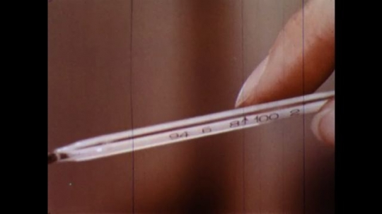 UNITED STATES 1960s: Close up of thermometer.