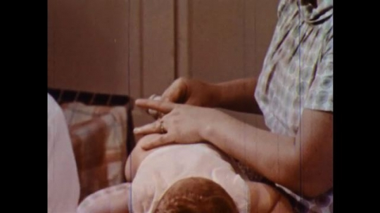 UNITED STATES 1960s: Woman takes baby