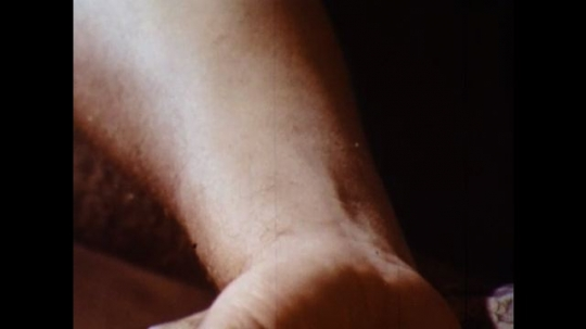 UNITED STATES 1960s: Close up of wrist, hand takes pulse.