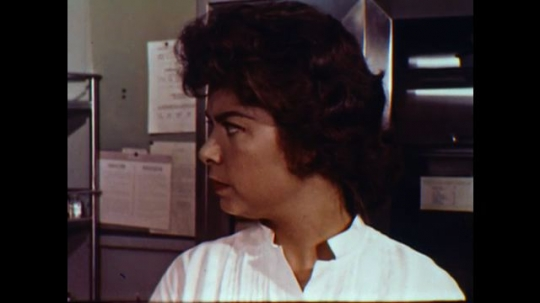 United States: 1960s: side profile of woman