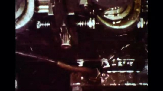 UNITED STATES 1960s: Slow motion close up of machine forming connectors.