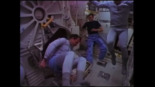UNITED STATES: 1980s: astronauts do gymnastics in space microgravity. Astronauts in Hawaiian shirts.