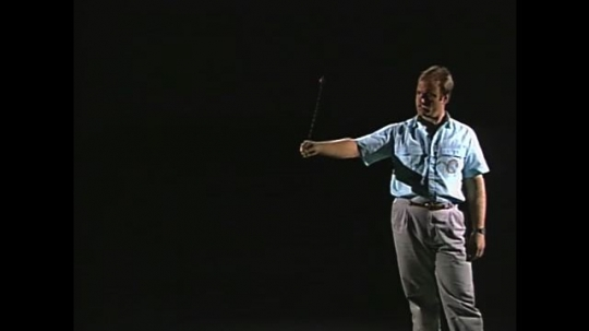 UNITED STATES: 1990s: man spins string and object